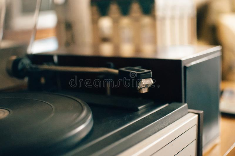 Vinyl record player on a sunset background over the city lights. Sound technology for DJs to mix and play music. Black vinyl. Record. 1980 vintage vinyl wood royalty free stock photography