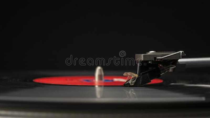 Vinyl record playing. Spinning vinyl record on a turntaple close up stock photos