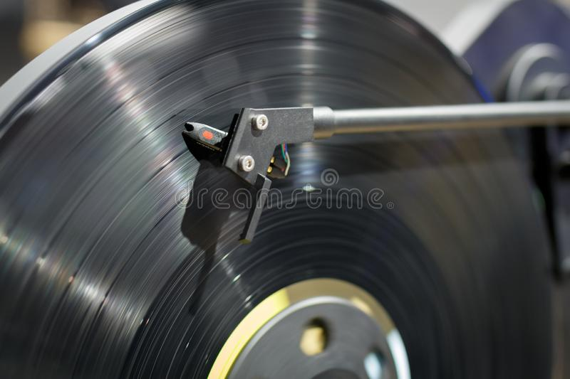 Vinyl record playing on a turntable. Close up view. stock image
