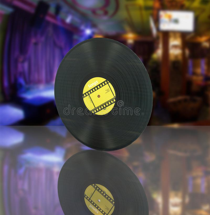 Vinyl record retro sound on bar background with reflection 3d stock illustration
