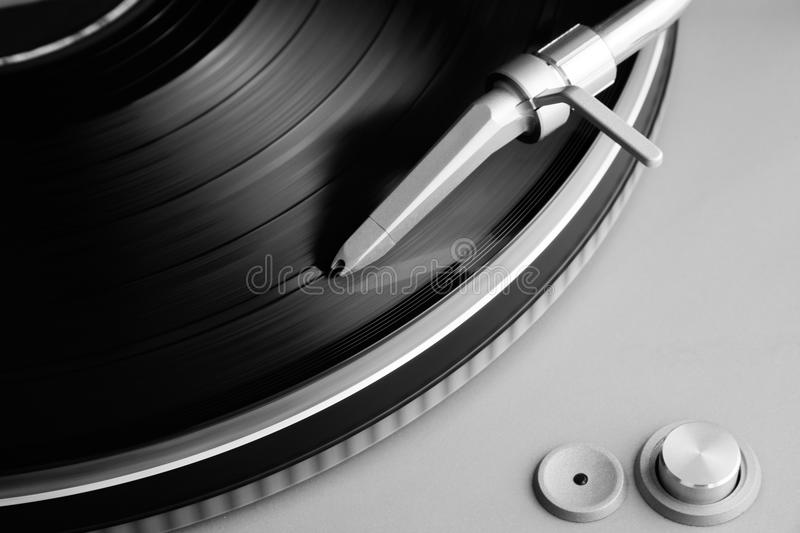 Vinyl record and turntable. Close-up on a turntable and a vinyl record stock image