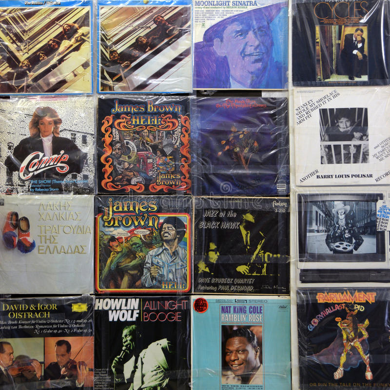 Vinyl records album covers. ATHENS, GREECE - APRIL 24, 2015: Wall with vintage vinyl records old lp album covers in plastic sleeves. Music background royalty free stock image