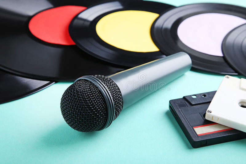 Vinyl records with cassette tapes stock images