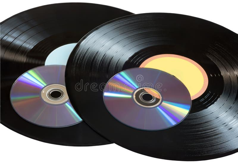 Vinyl records and CDs disks on a white background royalty free stock photo