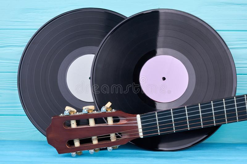 Vinyl records and guitar head. stock photography