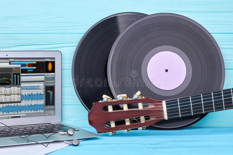 Vinyl records, guitar and laptop. royalty free stock photography