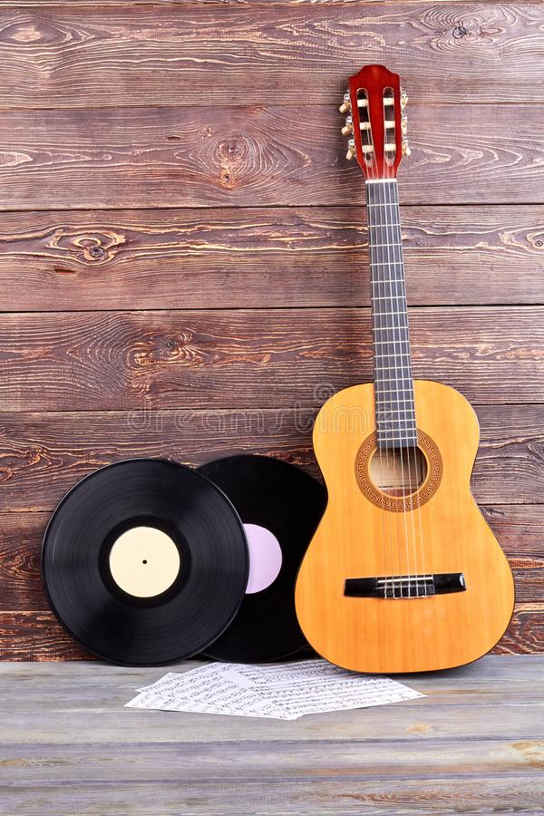 Vinyl records, guitar and musical notes. stock photos