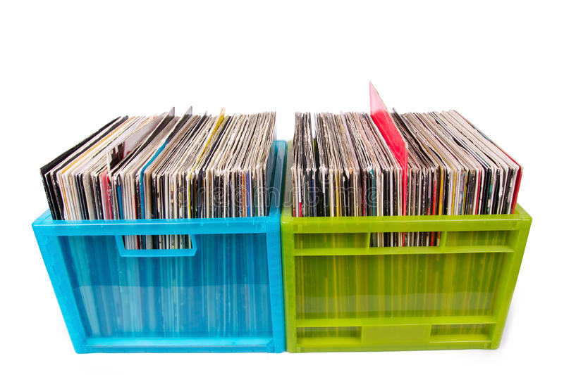 Vinyl records in plastic boxes isolated on white. Closed-up royalty free stock image