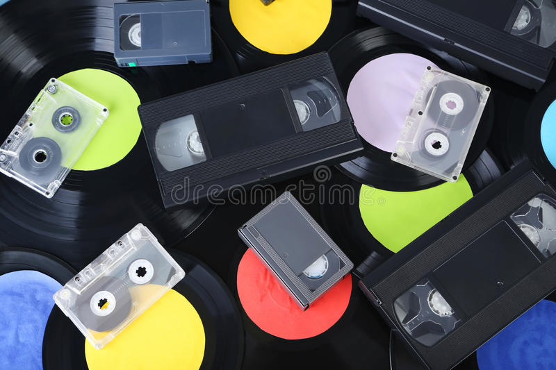 Vinyl records. With video and music cassette tapes stock images