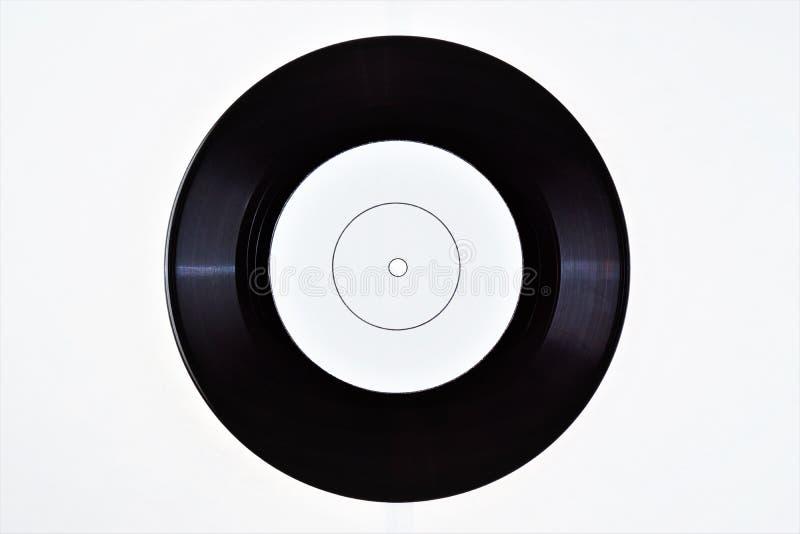 Vinyl ringsum Platte-Retro- Musik für Vereindiscos Eine Schallplatte, Diskette, Edison, der Träger der Audioinformationen - stockfotografie