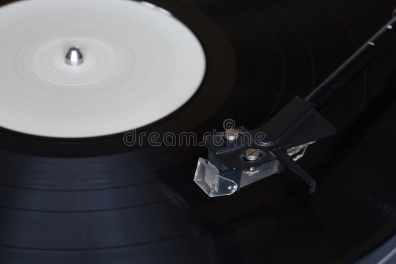 Vinyl speler De roterende schijf Hoofdclose-up stock afbeelding