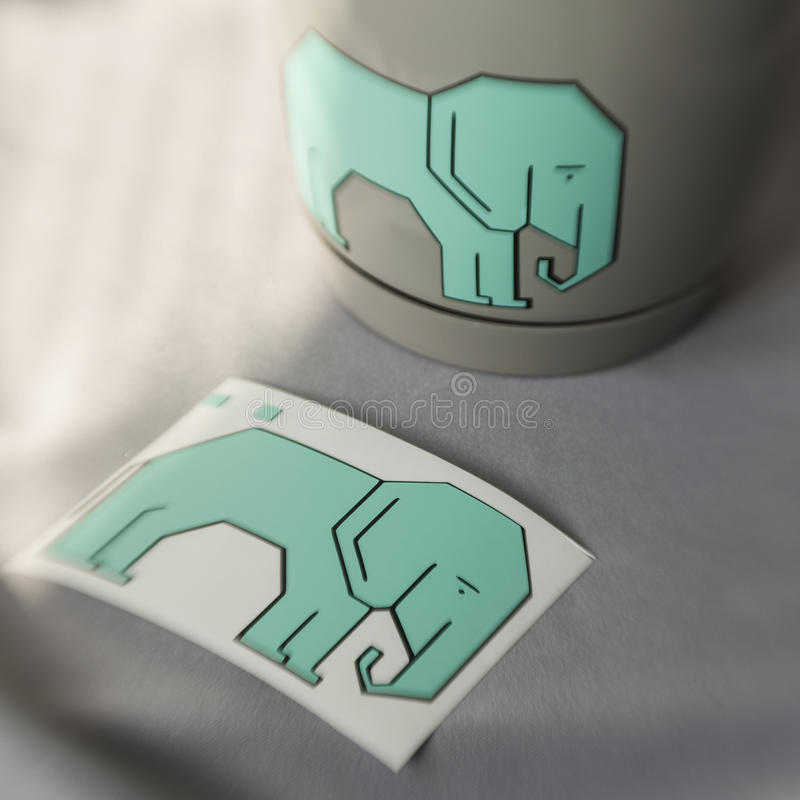 Vinyl sticker. Vinil sticker elephant black and mint on the sticker paper and planter stock photo