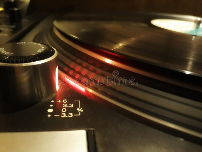 Vinyl times. Turnable turning with vinyl stock photography