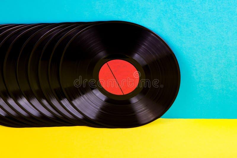 Vinyldisketten auf Hintergrund stockbild