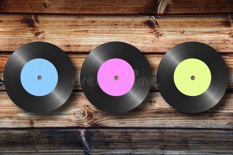 Vinyle sur le fond en bois photographie stock