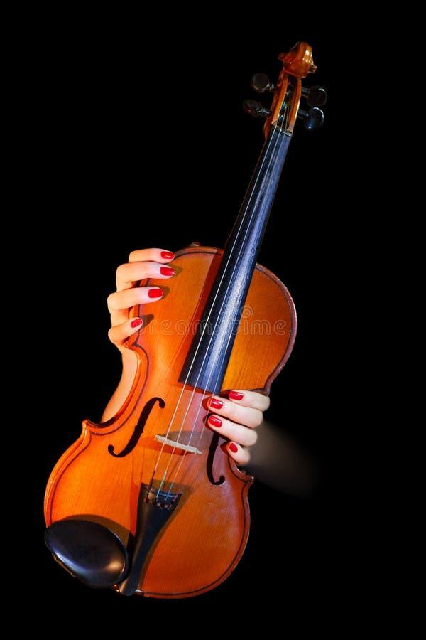violín y manos femeninas imagenes de archivo