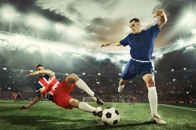 Football or soccer players colored in United Kingdom and European Unity flags royalty free stock photos