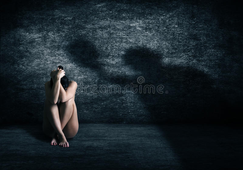 Violence against women. The woman is afraid of violence from their man royalty free stock images