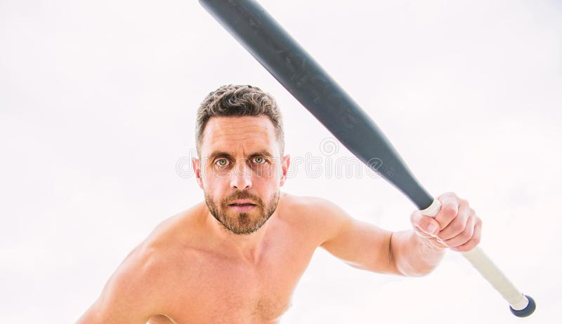 Violence and attack. Street fight. Attack and defence. Get ready attack. Man with baseball bat. Hooligan hits bat stock photo