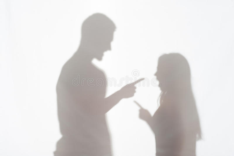 Violence of man against woman. Silhouette of men and women standing on white background making clear their relationships royalty free stock photo