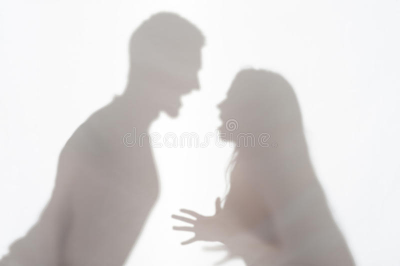 Violence of man against woman. Silhouette of men and women standing on white background and women wanted to explain something gesticulating with her hands royalty free stock photos