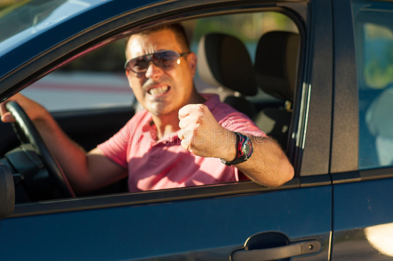 Violent driver. Macho type of driver about to lose it royalty free stock photography