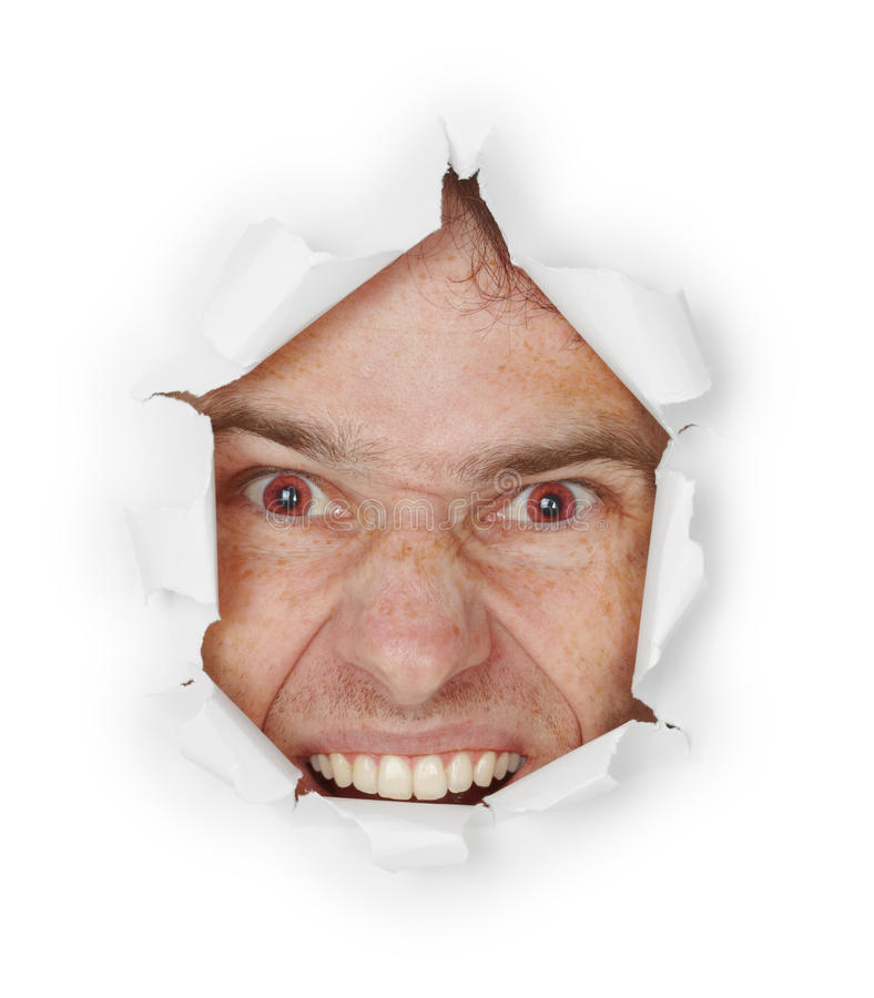 Download Violent Evil Man Looks Through A Hole Royalty Free Stock Photo - Image: 16552025