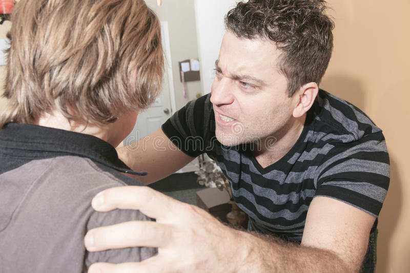 Violent father hit the teenager of the family. A violent father hit the teenager of the family royalty free stock photography