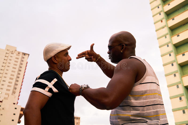 Violent People Arguing And Fighting For Drugs Crime And Violence. Substance abuse, crime, social issues, drugs and narcotics. Hispanic and black gang members stock photos