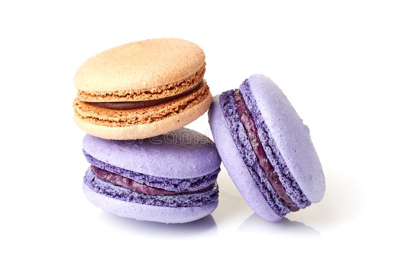 Violet and beige macarons on white royalty free stock image