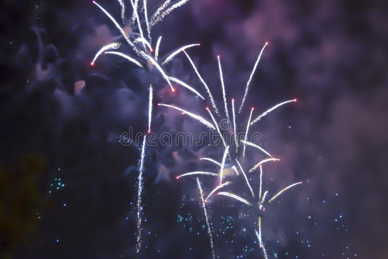 Violet blue bright blurred fireworks effect abstract colorful background holiday. Blue bright blurred fireworks effect abstract colorful background holiday royalty free stock image