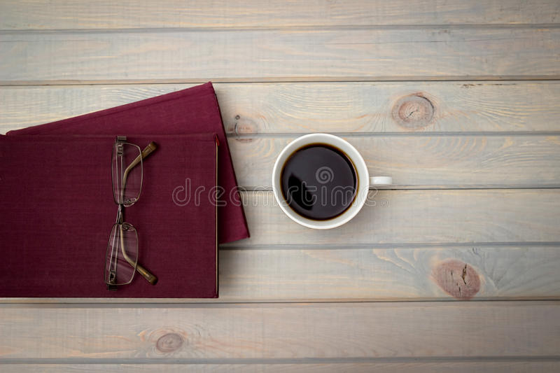 Violet books and glasses. White cup of coffee royalty free stock photo