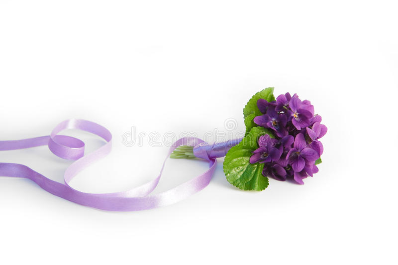 Violet bouquet with silk bow stock images