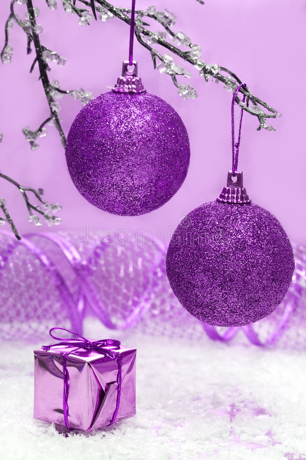 Violet Christmas balls. And gift box stock images