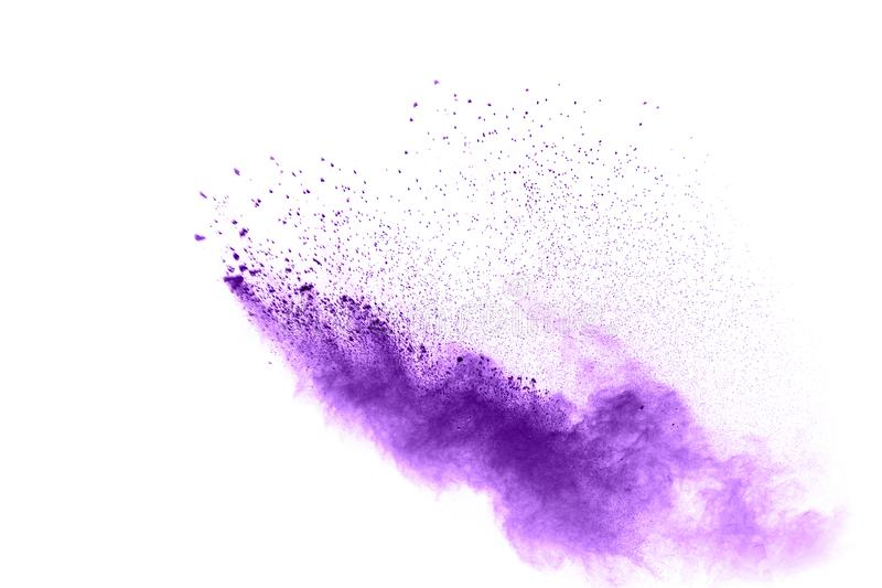 Violet color powder explosion cloud isolated on white background. Closeup of purple dust particles splash isolated on background royalty free stock image