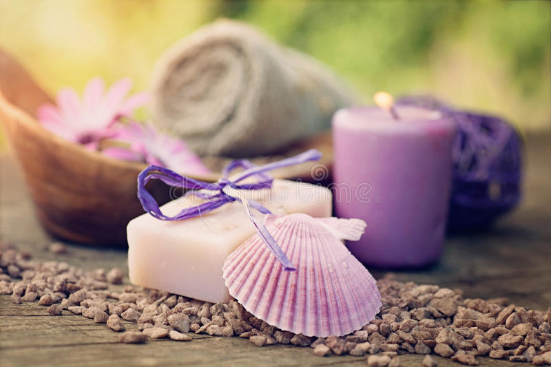 Violet dayspa nature set. Spa and wellness setting with natural soap, candles and towel. Violet dayspa nature set dayspa nature set royalty free stock photography