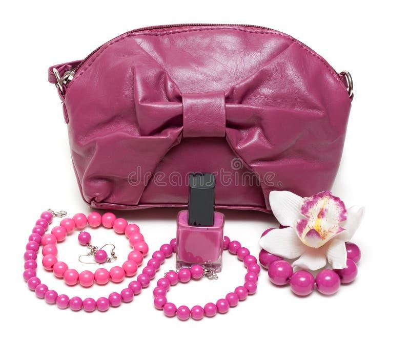 Violet feminine bag, necklace stock photo