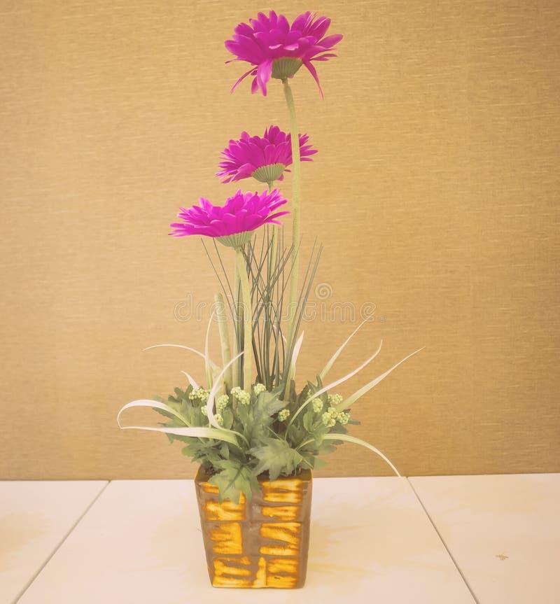 Violet flower vase stock image