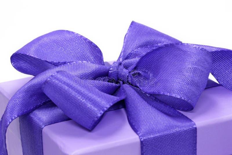 Violet gift box. On white background stock image