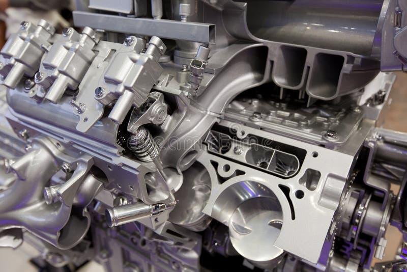 Violet glares on mighty ultramodern engine. Violet glares on grey mighty modern engine royalty free stock photo