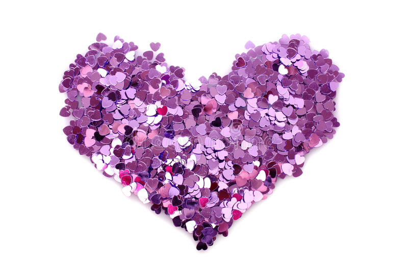Violet hearts. In the form of confetti on white stock images