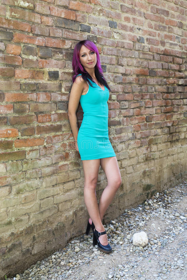 Violet Light. Stunning model with violet hair posing outdoor royalty free stock photos