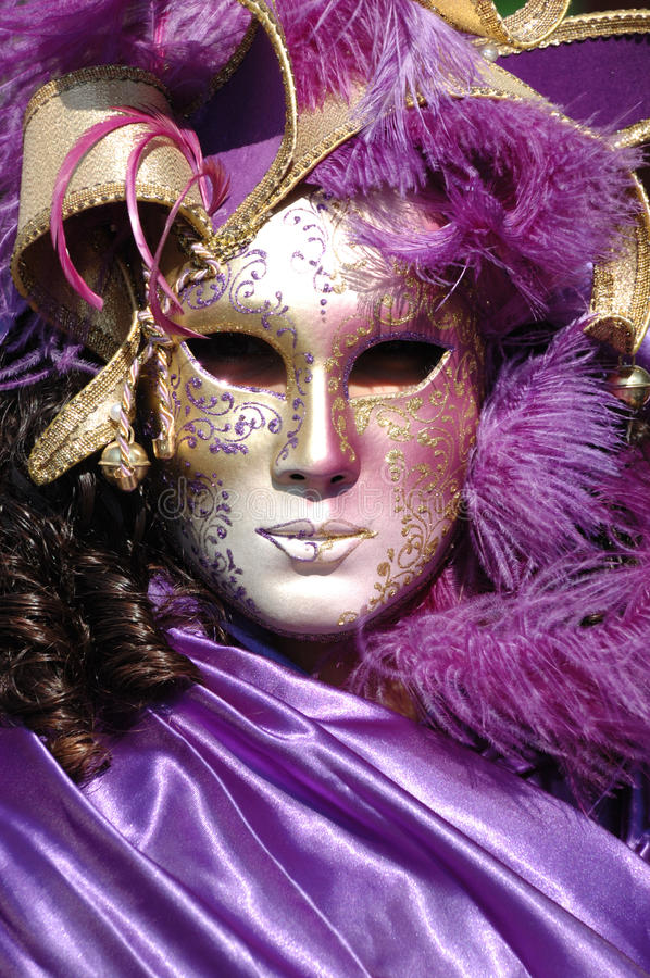 Violet mask at Carnival of Venice 2011 stock images