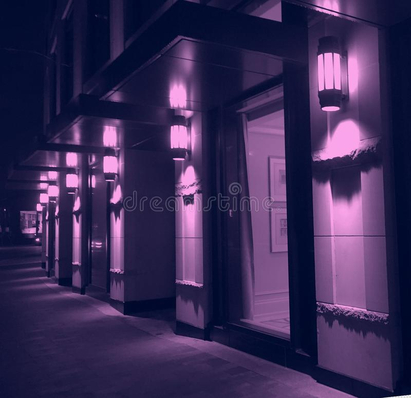 Free Violet Night Lighting Of Modern City Building Facade Royalty Free Stock Images - 113531799