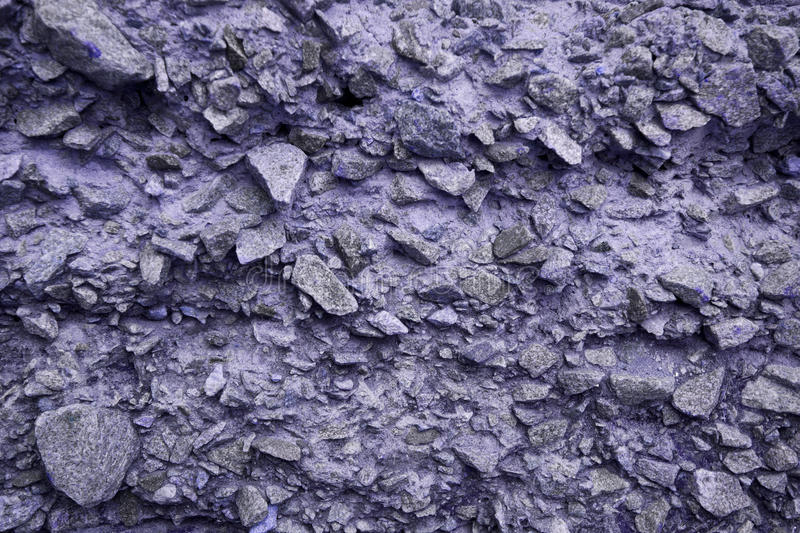 Violet stone wall texture stock photography