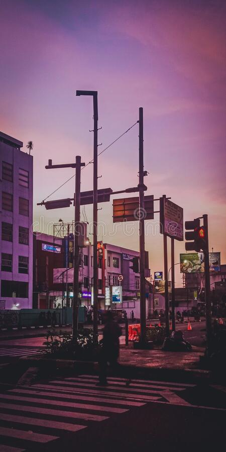 Violet sunset in traffic light bandung indonesia stock photo