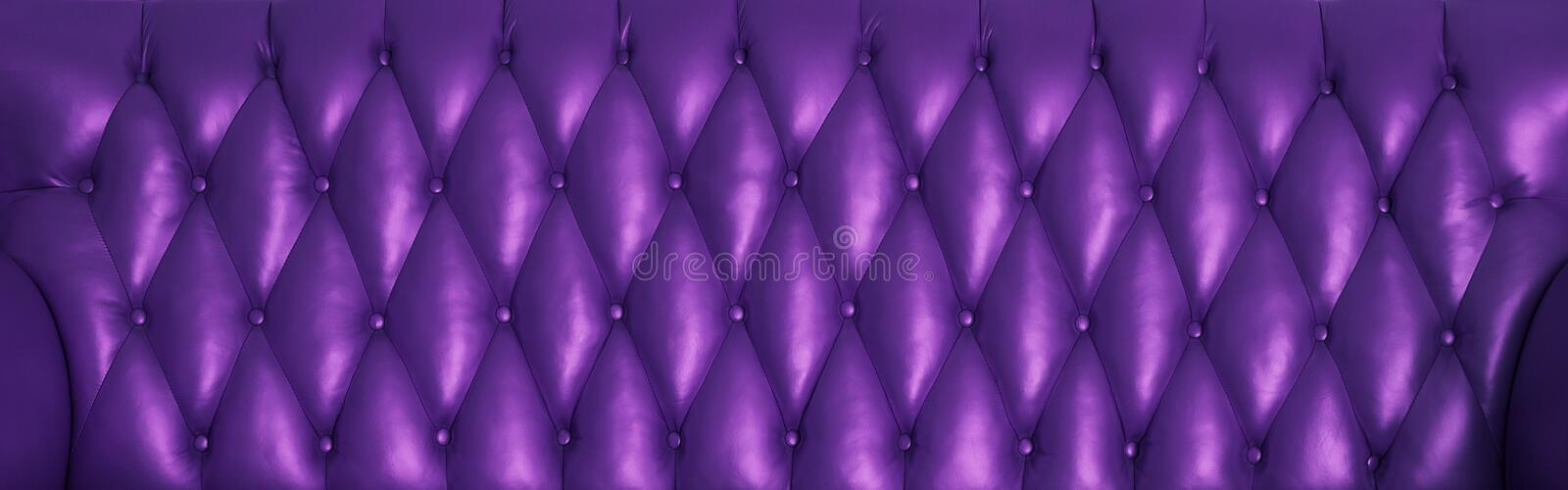 The violet surface of the leather. Back of the vintage couch royalty free stock photo