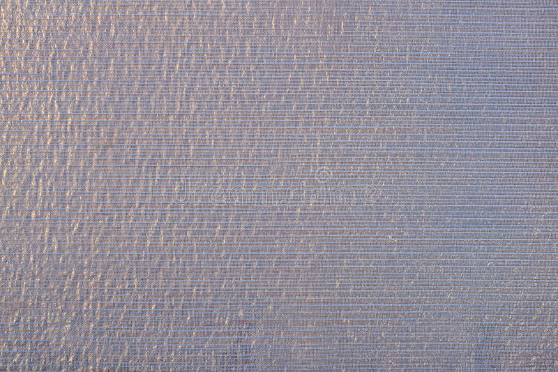 Violet transparent caprone cloth as background texture stock photos
