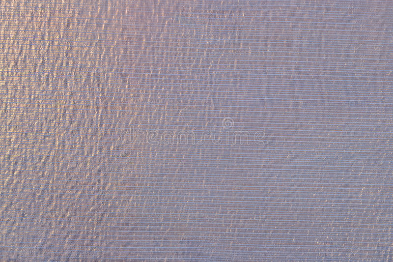 Violet transparent caprone cloth as background texture. Close up stock photos