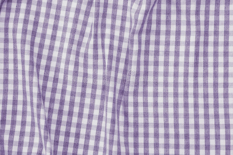 Violet and white checkered fabric background texture royalty free stock photography